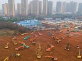 ভাইরাসে মৃত্যু ২৬ জনের, চারদিনে ১০০০ শয্যার হাসপাতাল করছে চীন